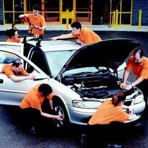 Mechanics Working On A Vehicle